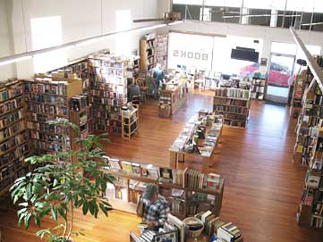 Interior view of Winston Smith Books store from upstairs looking down