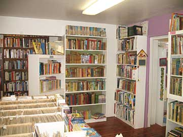View of books filling shelves at Winston Smith Books